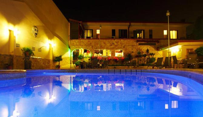 Adventure-Inn-pool-at-night